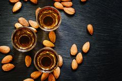 Amaretto almond liqueur with a dark background, top view royalty free stock photos