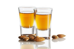 Amaretto and almonds isolated Royalty Free Stock Images