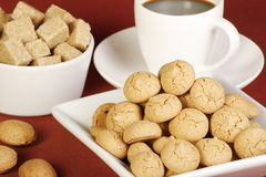 Amaretto biscuits. Dish of amaretto biscuits coffee sugar and almonds on a red tablecloth Stock Images