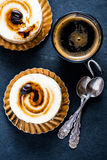 Amaretto and coffee italian dessert on black slate board stock photography
