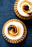 Amaretto and coffee italian dessert on black slate board Royalty Free Stock Photos