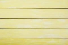 Amarillee el fondo de madera coloreado, fondo de madera agradable para los diseñadores Tabla de la madera como fondo Fotos de archivo libres de regalías