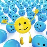 Amarillee el smiley de salto entre triste Fotografía de archivo