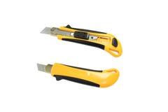 Amarillo del cortador del cuchillo en el fondo blanco Imágenes de archivo libres de regalías