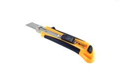 Amarillo del cortador del cuchillo en el fondo blanco Foto de archivo libre de regalías