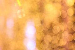 Amarillo del oro del fondo de Bokeh colorido de la Feliz Navidad, brillo de la iluminación del bokeh de la Feliz Año Nuevo en el  Fotografía de archivo