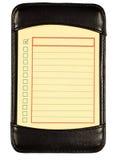 Amarillo para hacer la lista en el folio de cuero negro XXXL fotografía de archivo