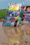 Amarillo, Texas - JULY 18, 2014: The Cadillac Ranch, Amarillo, Texas. Partly covered by water and mud Stock Image