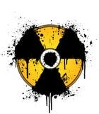 Amarillo y negro nucleares de la salpicadura de la tinta del símbolo Imagen de archivo