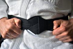 Amarração do cinturão negro imagem de stock