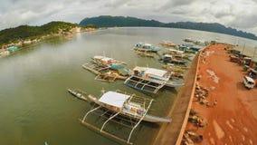 Amarrez à quai avec des bateaux dans la ville de Coron PALAWAN philippines image libre de droits