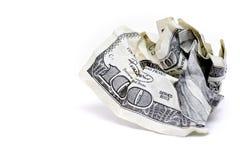 Amarrotado cem contas de dólar Fotografia de Stock Royalty Free