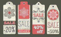 Amarrote etiquetas do Natal com oferta da venda, vetor Fotografia de Stock Royalty Free