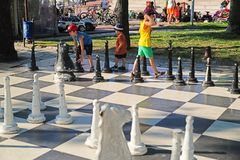 Outdoor chess activity on a park stock photography