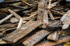 Amass of old wooden planks. For reconstruction stock images