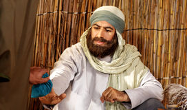 Amateur actor. Egyptian arab amateur actor playing a role in an religious film Stock Photography