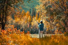 Amateur angler. Fishing on the autumn river stock images