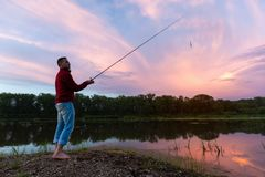 Amateur angler fishing on the coast stock images