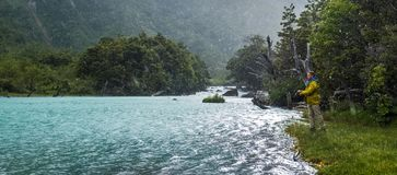 Amateur angler fishing on the river. In a harsh weather conditions. Chile stock image