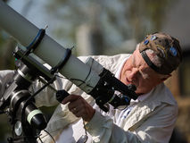 Amateur astronomer setting up a solar filter telescope for Astronomy Day Stock Images