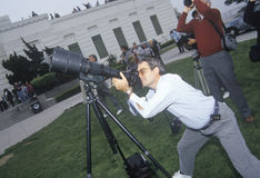 Amateur astronomers. Using a telescope at Griffith Park Observatory, Los Angeles, CA stock images