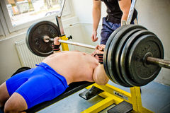 Amateur bench press championship. PECS - JANUARY 29: Unknown man participates in Amateur bench press championship in Professors GYM January 29, 2011 in Pecs Royalty Free Stock Photography