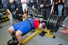 Amateur bench press championship. PECS - JANUARY 29: Unknown man participates in Amateur bench press championship in Professors GYM January 29, 2011 in Pecs Stock Images