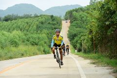 Amateur bike athletes make the most of their efforts in the Bicycle race Charity Trip. `Nhong Yai Country Road, please ask` on 2018/06/24 at Nhong Yai,Chonburi stock photography