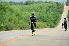 Amateur bike athletes make the most of their efforts in the Bicycle race Charity Trip. `Nhong Yai Country Road, please ask` on 2018/06/24 at Nhong Yai,Chonburi stock photos