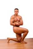 Amateur bodybuilder. Posing in a room royalty free stock photo