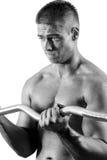 Amateur bodybuilder. Training his bicep royalty free stock photo