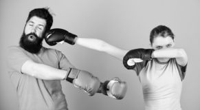 Amateur boxing club. Equal possibilities. Strength and power. Family violence. Man and woman in boxing gloves. Boxing royalty free stock photo