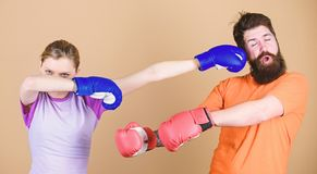 Amateur boxing club. Equal possibilities. Strength and power. Family violence. Man and woman in boxing gloves. Boxing stock photos