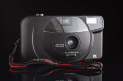 Amateur camera on the black background isolated Royalty Free Stock Photo