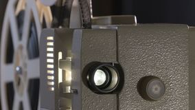 Amateur cinema. Projector for 8mm film. 1960s, 1970s, 1980s years. Home cinema. Film super 8. Footage clip 4k