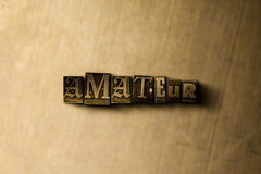 AMATEUR - close-up of grungy vintage typeset word on metal backdrop Stock Photo