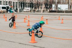 Amateur competition of children to balance bicycle on Lenin Square. City Tula. Russia - April 06, 2019: amateur competition of children to balance bicycle on royalty free stock photo