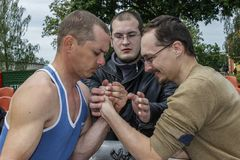 Amateur competitions on an armwrestling in the Gomel region of Belarus. Arm wrestling is a popular form of combat sports. During a match of the same hand the royalty free stock image