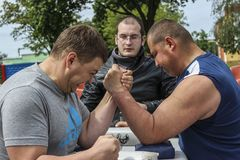 Amateur competitions on an armwrestling in the Gomel region of Belarus. Arm wrestling is a popular form of combat sports. During a match of the same hand the royalty free stock photography