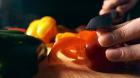 Amateur cook cutting juicy red sweet pepper. Healthy eating concept. 4K slow motion clip. Amateur cook cutting juicy red sweet pepper. Healthy eating concept. 4K stock video footage