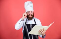 Amateur cook read book recipes. Culinary arts concept. Man learn recipe. Try something new. Cookery on my mind. Improve. Cooking skill. Book recipes. According stock image
