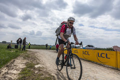 Amateur Cyclist Riding on a Cobblestoned Road Royalty Free Stock Photo