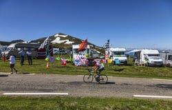 Amateur Cyclist on the Road of Le Tour de France. Port de Pailheres,France- July 6, 2013:An amateur cyclist passes in front of the caravans of fans near the Col stock photo