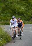 Amateur Cyclists. Gourette, France- July 15th, 2011:A group of amateur cyclists climbing the road to mountain pass Aubisque, in Pyrenees mountains, before Royalty Free Stock Image
