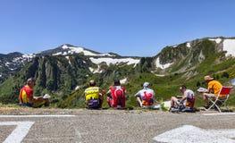 Amateur Cyclists on Col de Pailheres. Port de Pailheres,France- July 6, 2013: Amateur cyclists restind on the roadside and admiring the landscape at the Col de royalty free stock image