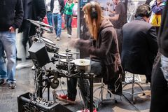 Amateur drummers play on Roland drums set in V-Drums Royalty Free Stock Photos