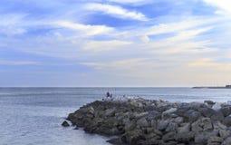 Oeiras – Amateur Fishermen and Breakwater Royalty Free Stock Image