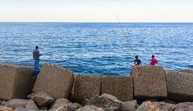 Amateur fishermen who fish from the dock. In a port royalty free stock photos
