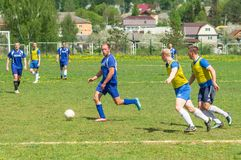 Amateur football match in Kaluga region of Russia. The Kaluga region annually hosts the football championship, in which teams from different cities of the stock photos