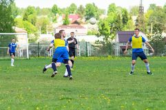 Amateur football match in Kaluga region of Russia. The Kaluga region annually hosts the football championship, in which teams from different cities of the stock photography